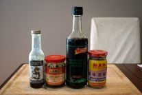From left to right: Sesame oil, chili oil, soy sauce, sesame paste.